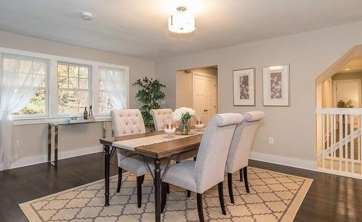 a staged dining room with white furniture