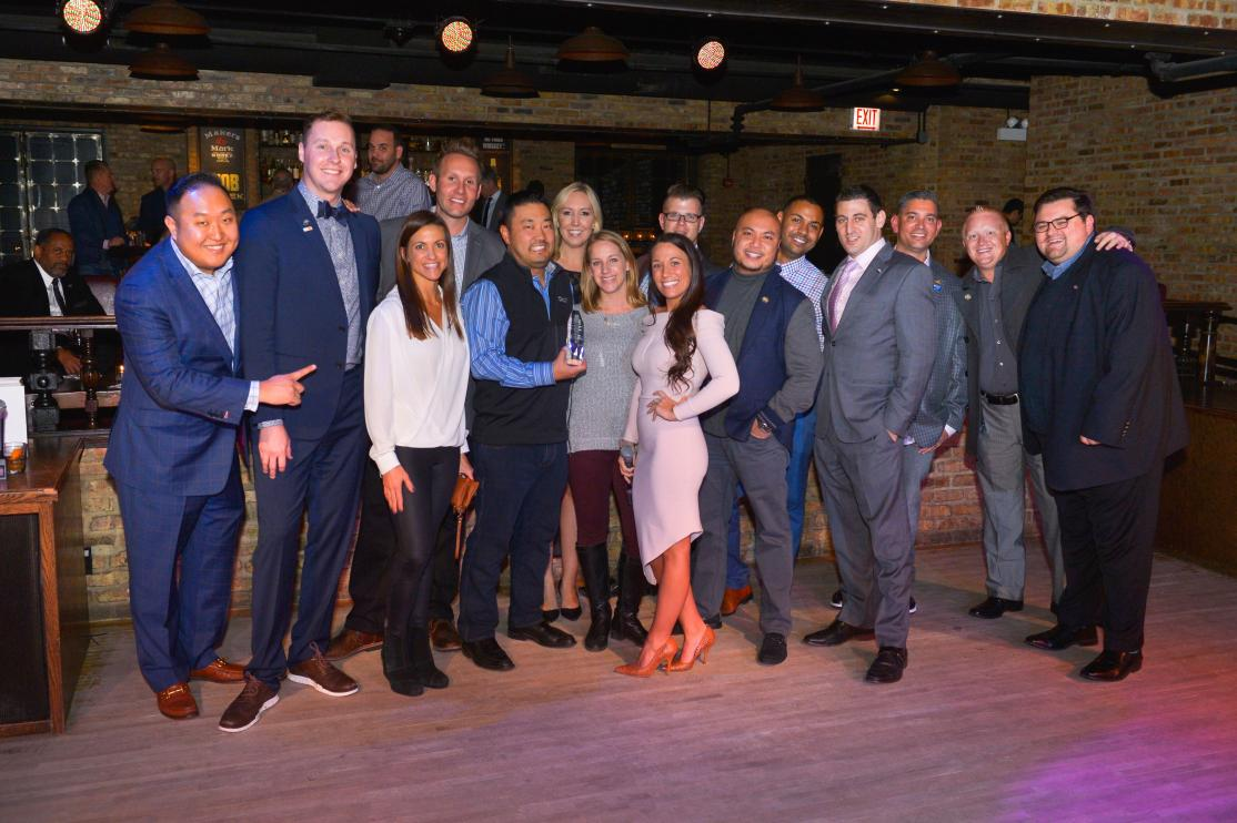 a group of people at the ypn of the year event in 2018