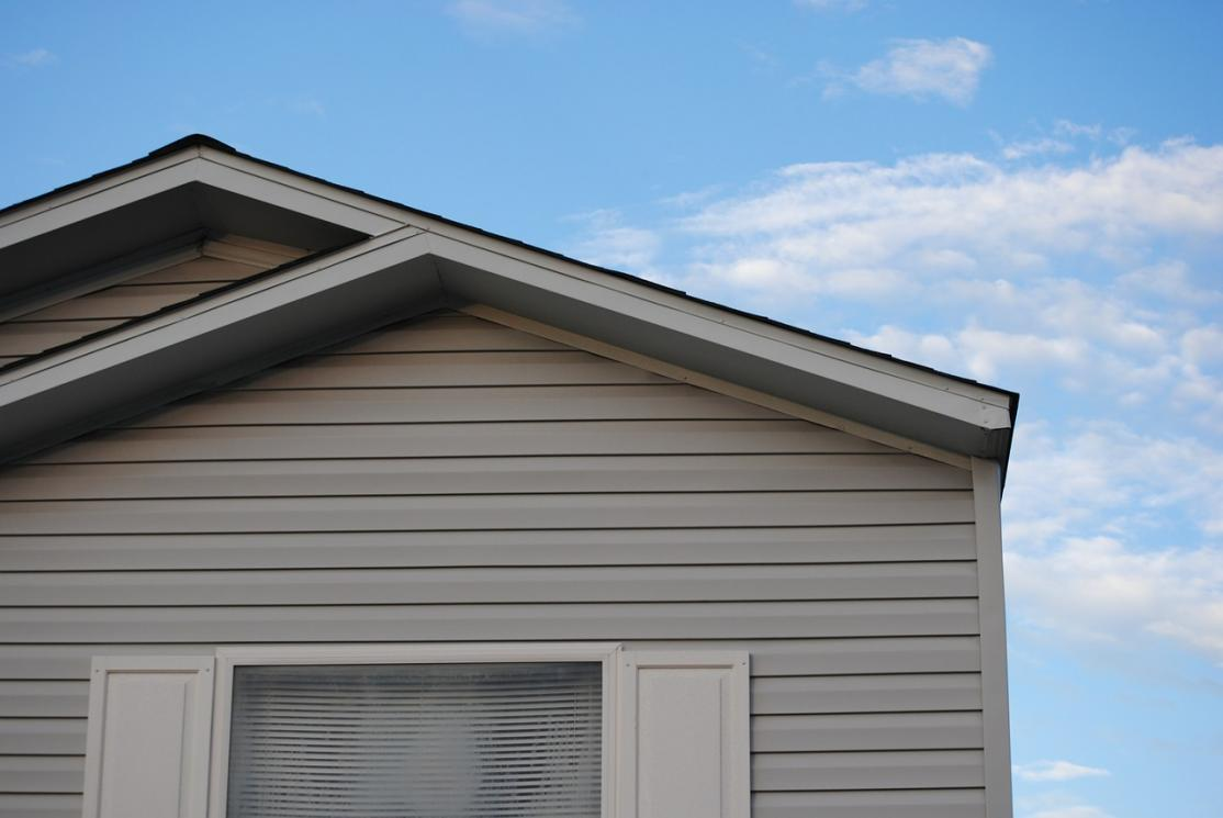 the top of a grey house and the sky