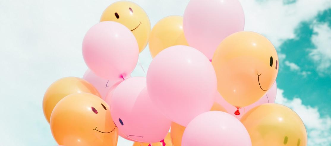 pink and orange smiley face balloons