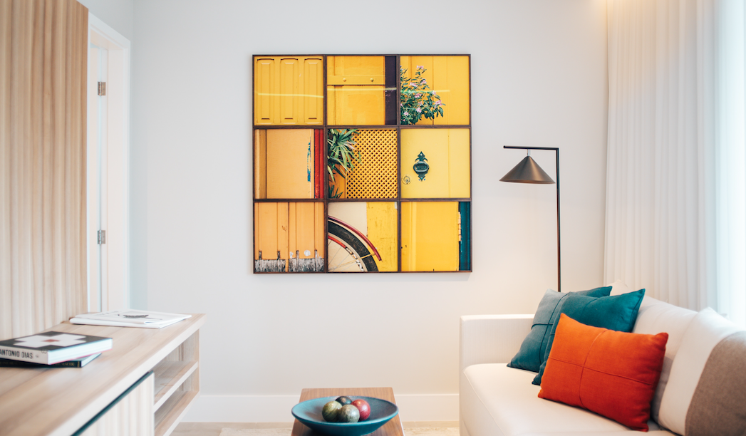 a staged living room with yellow artwork