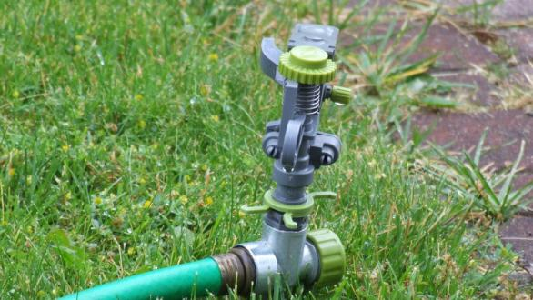 A sprinkler ready to water a lawn