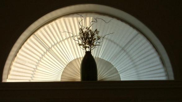 A vase silhouetted in an entryway