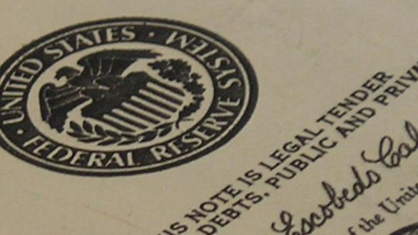 U.S. paper currency showing the Federal Reserve symbol