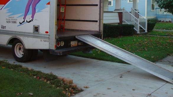 A ramp from a moving van to a small home