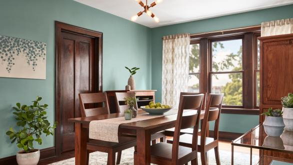 green dining room with wood trim