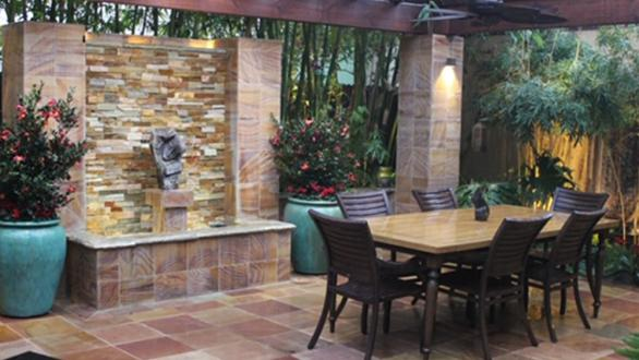 patio space with dining area and water feature