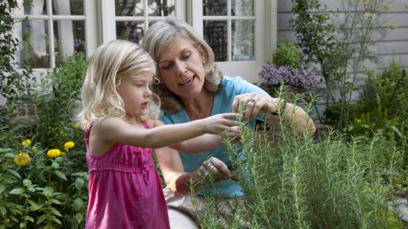 grandmother in garden with granddaughter