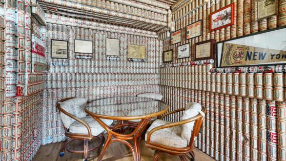 dining room covered in beer cans