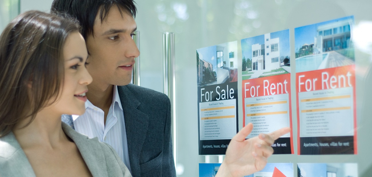 Couple looking at rental ads