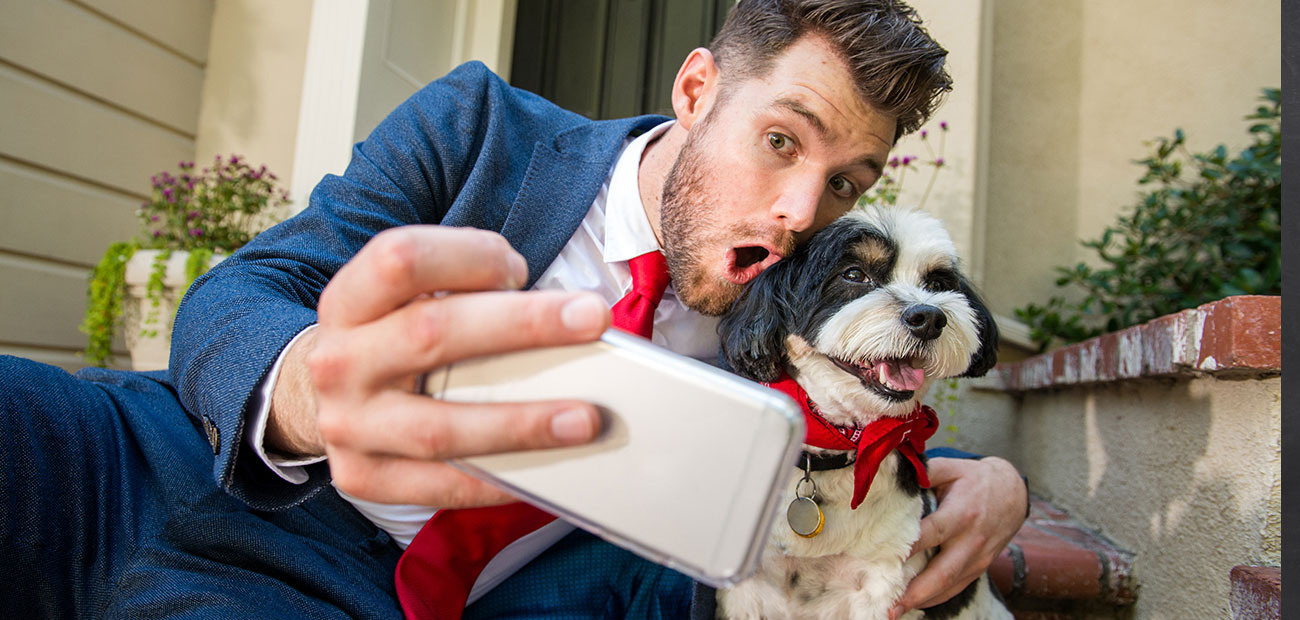 Businessman Taking Selfie with Dog