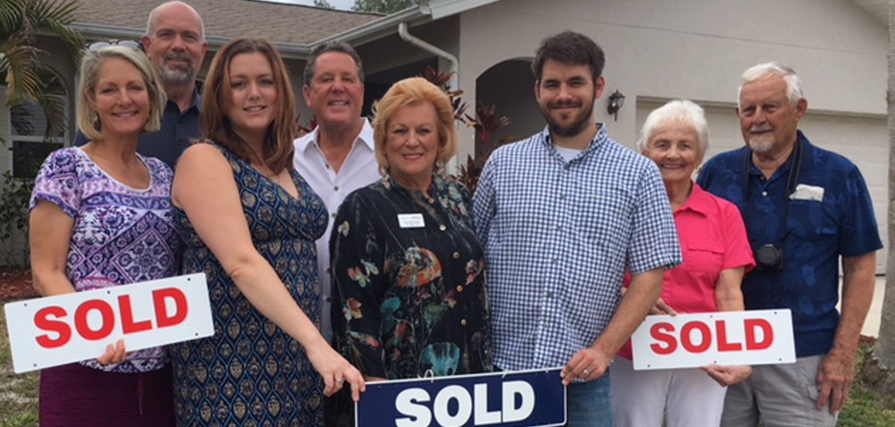 Real estate professional Charlotte Hedge, center, with four generations of the LaBossiere family