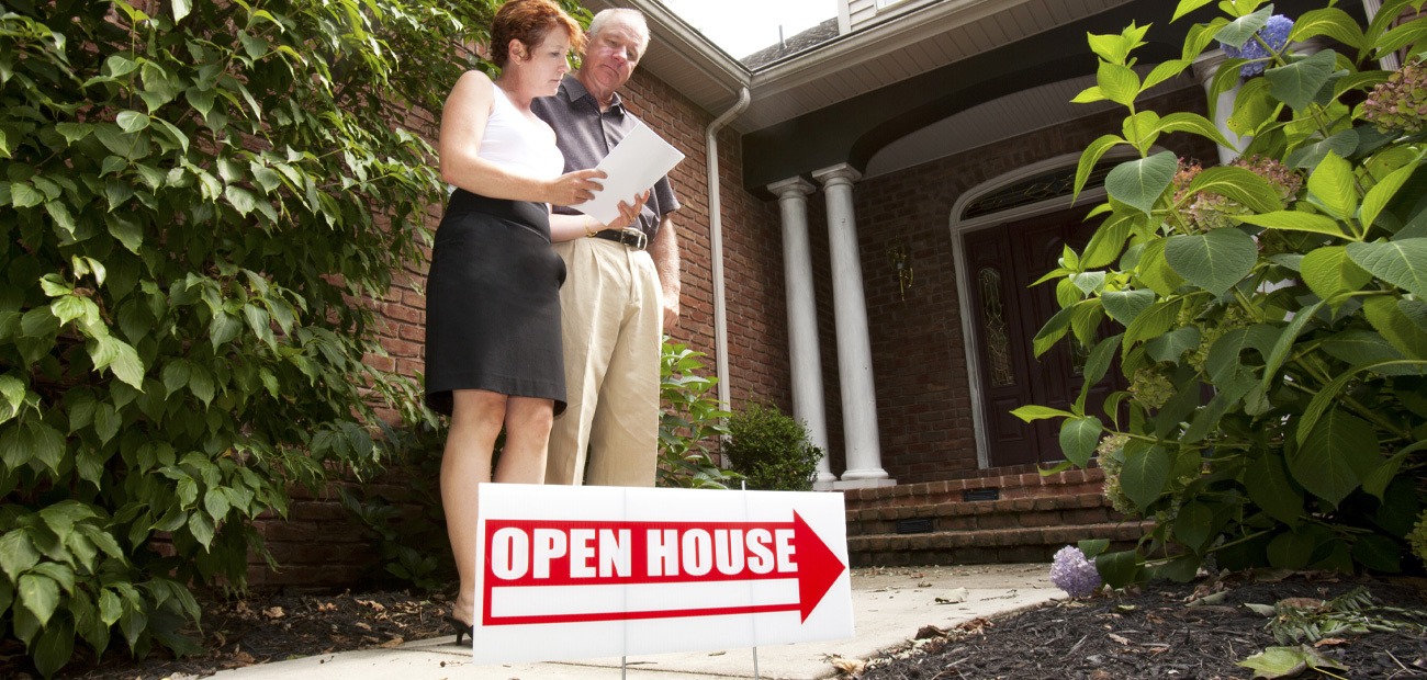 couple looking at sell sheet at open house