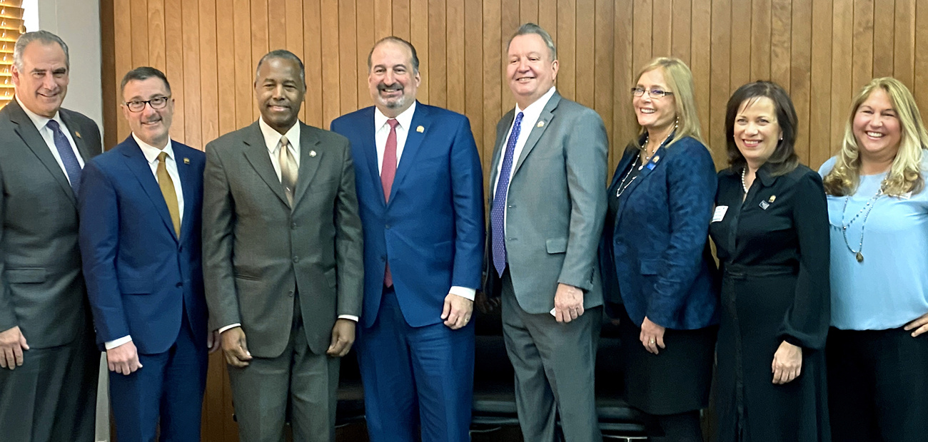 President Malta, second from left, and other NAR leaders with Housing & Urban Development Secretary Ben Carson.