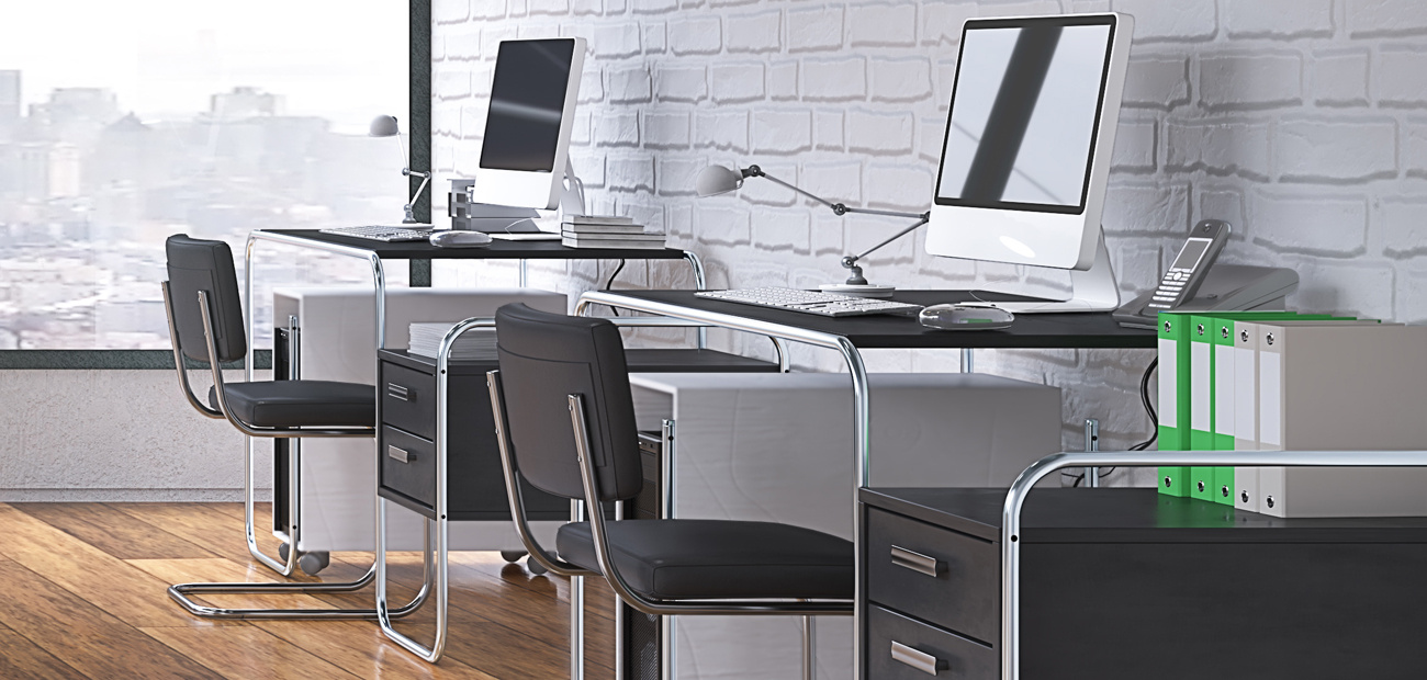 two office desks spaced apart