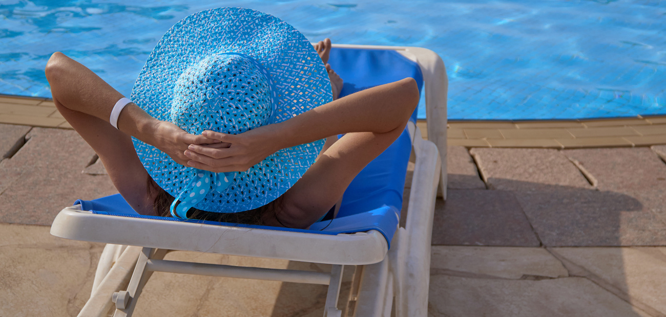 woman on lounge chair by pool