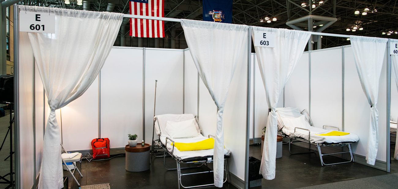 Hospital bed booths are set up at the Jacob K. Javits Convention Center which was turned into a hospital to help fight coronavir