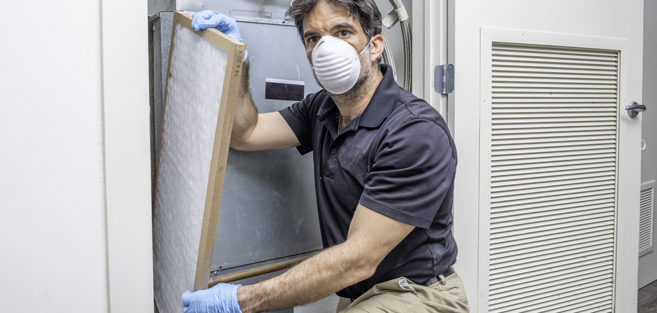 Inspector looking at furnace