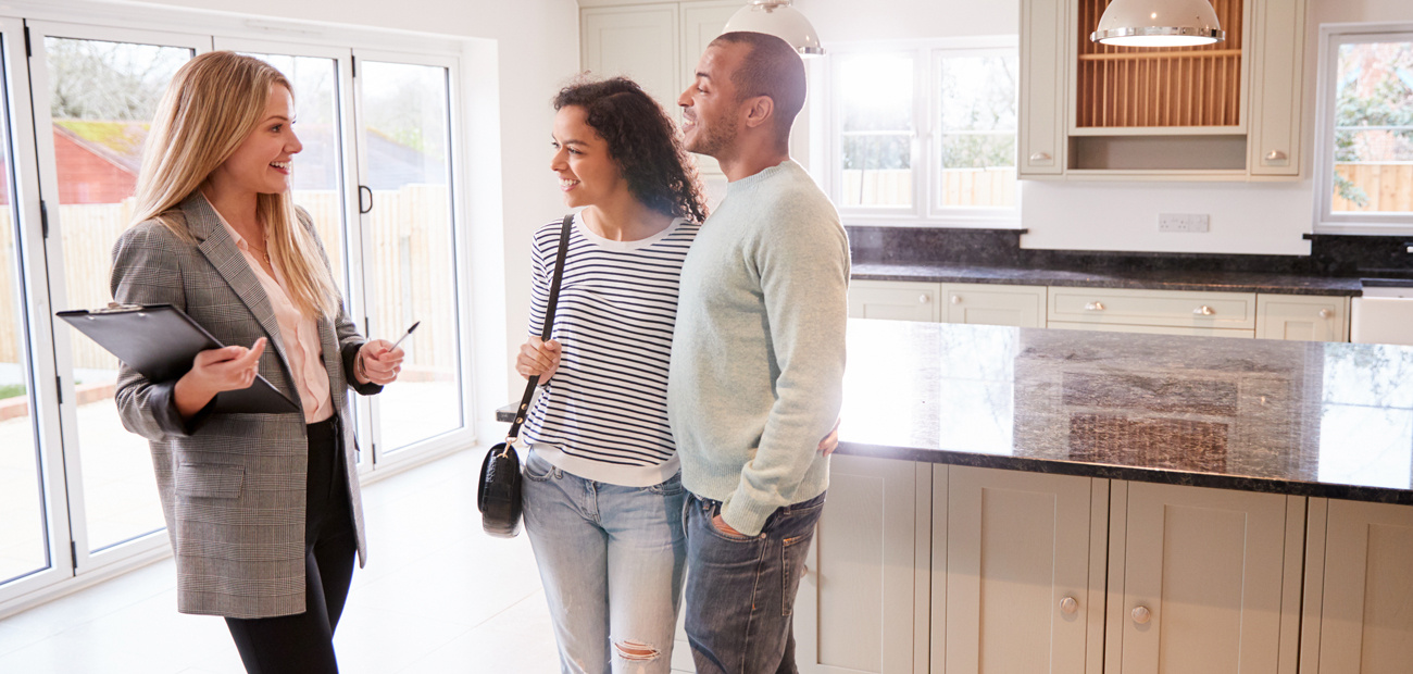 Couple viewing empty home