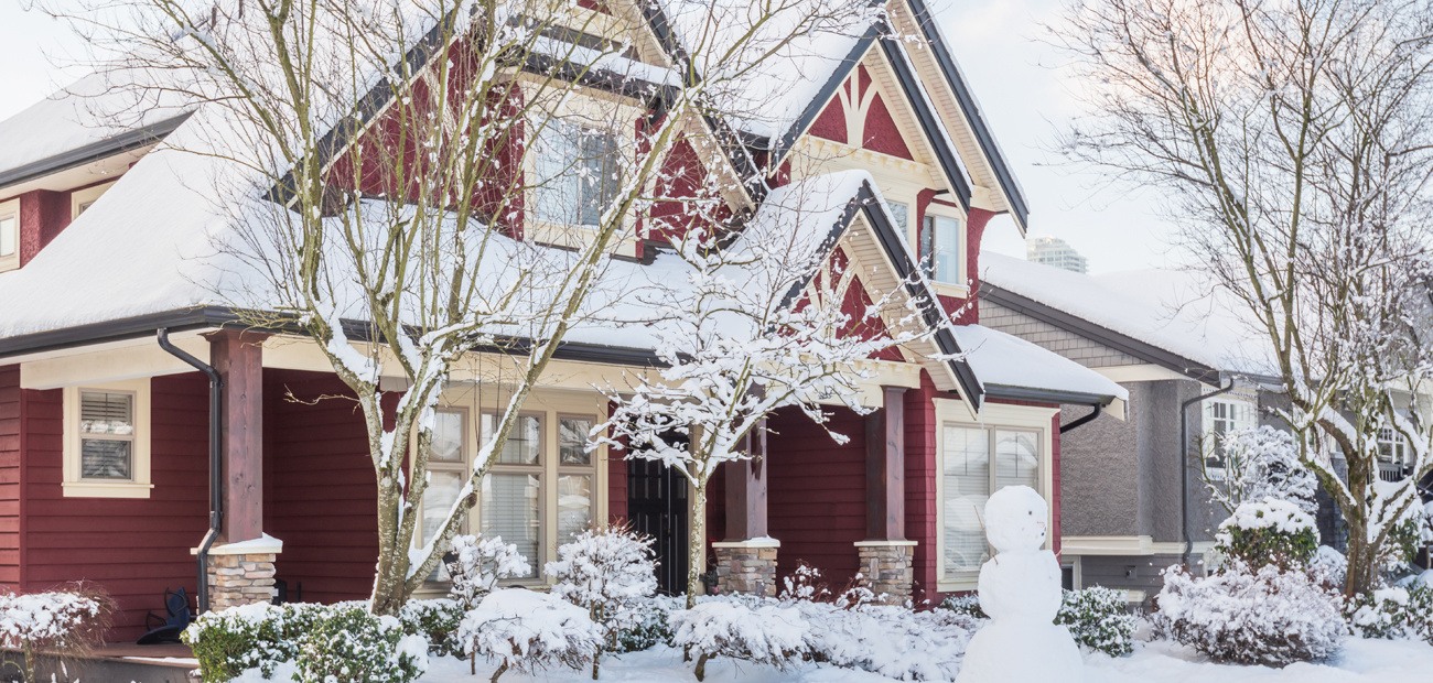 red home with snowman in front yard