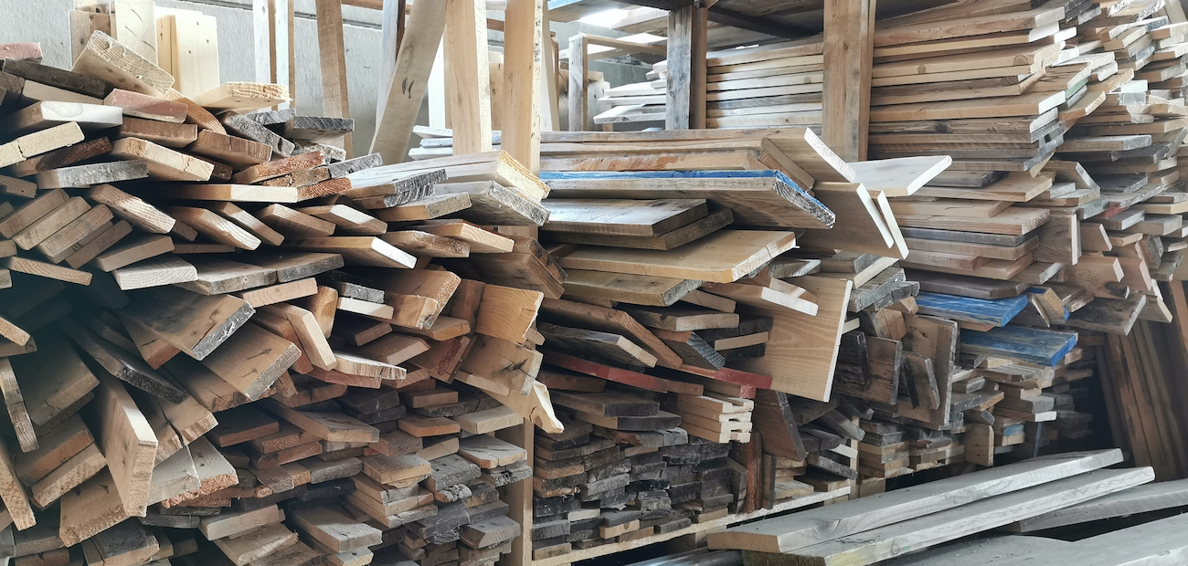 Pallet of wood planks.
