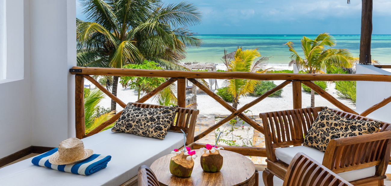 Vacation home deck overlooking a beach.
