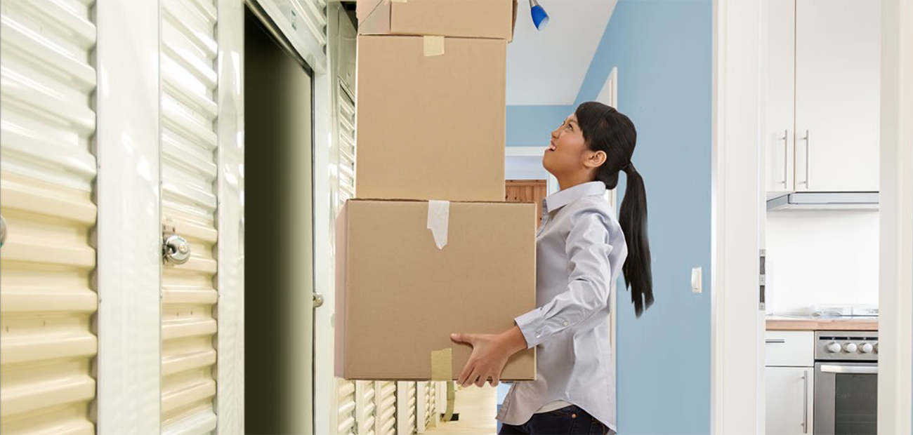 Woman Juggling Moving Boxes