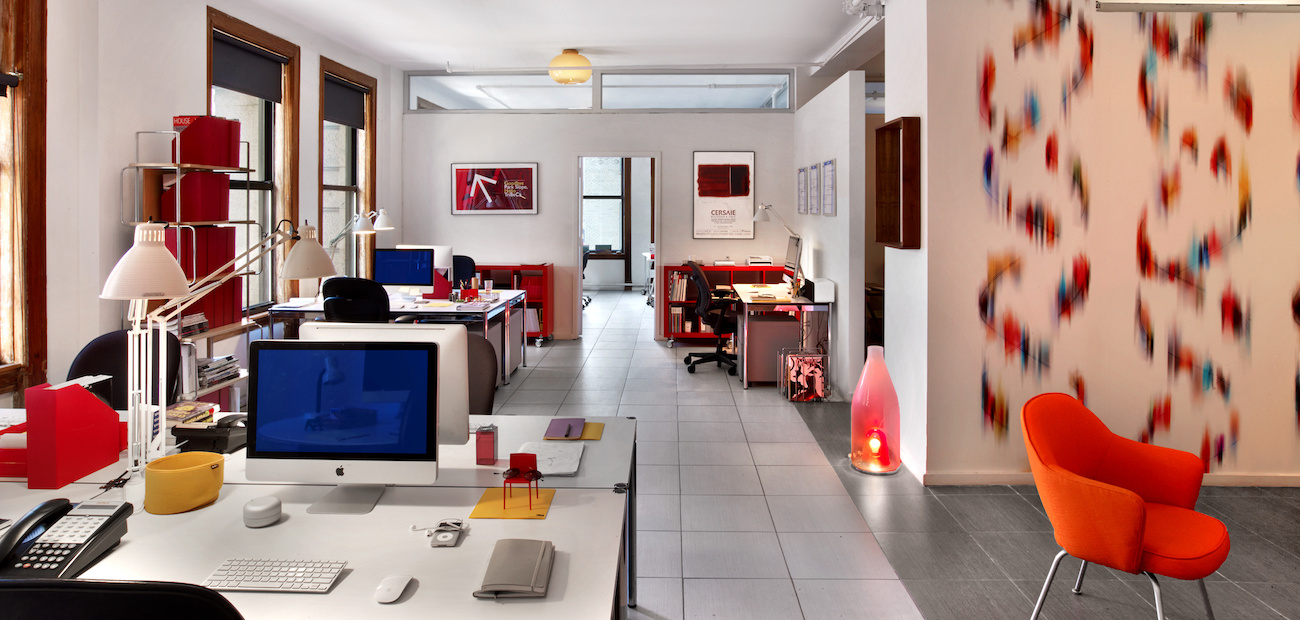 Pops of red energize this office space.