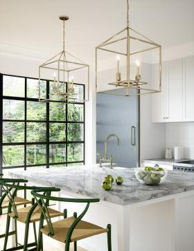 twin brass light fixtures over kitchen island