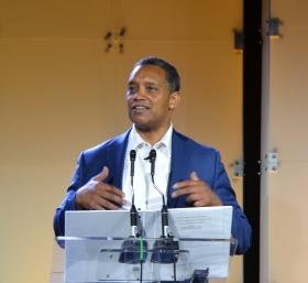 Washington, D.C., Attorney General Karl Racine addresses the crowd at iOi